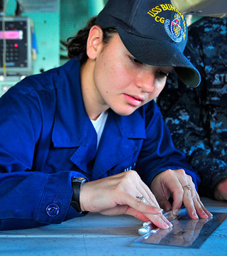 Female Navy service measuring with ruler member on ship