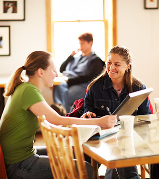 Students talking at table